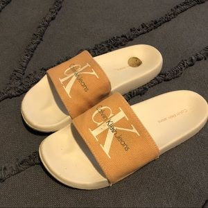 CK pink and white slide sandals